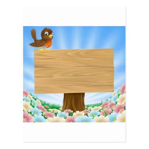 Pájaro en fondo de madera de la muestra tarjetas postales