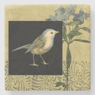 Pájaro en fondo del negro y del vintage posavasos de piedra