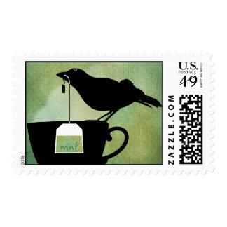Pájaro en sellos de la taza de té