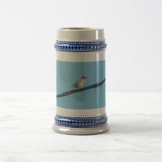 Pájaro en un alambre jarra de cerveza