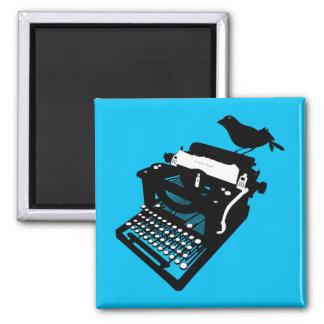 Pájaro en un imán de la máquina de escribir fondo
