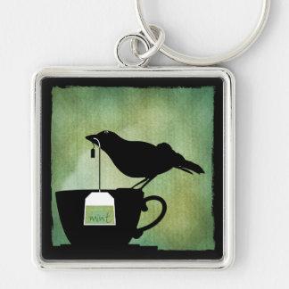 Pájaro en un llavero de la taza de té