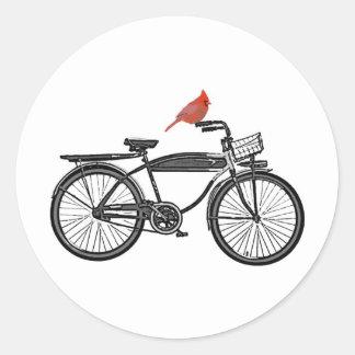 Pájaro en una bici pegatina redonda