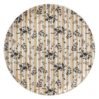 Pájaro en una placa del cerezo platos para fiestas