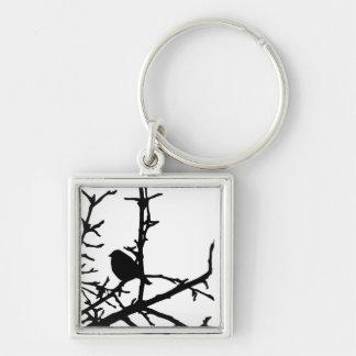 Pájaro en una rama llavero cuadrado plateado