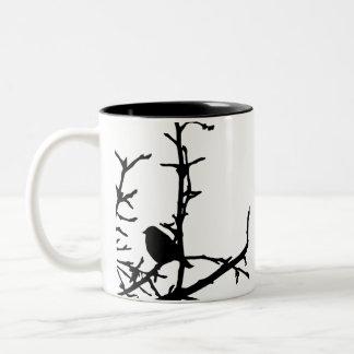 Pájaro en una rama tazas