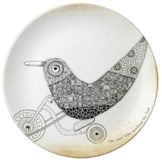 Pájaro en una rueda grande platos de cerámica