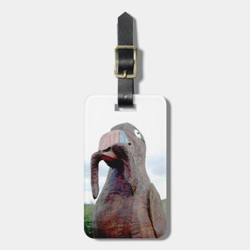 Pájaro enorme con el gusano en pico etiquetas maletas