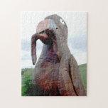 Pájaro enorme con el gusano en pico rompecabeza con fotos
