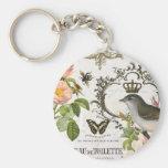 Pájaro francés del vintage con llavero de la coron