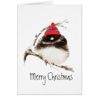 Pájaro lindo del invierno en el gorra, navidad, tarjeta de felicitación