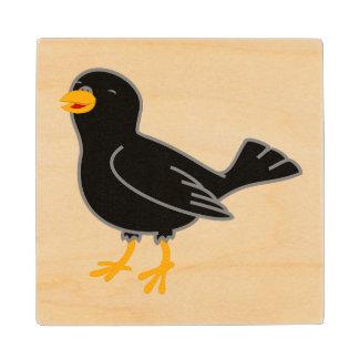 Pájaro negro posavasos de arce