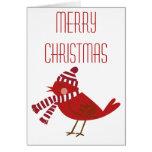 Pájaro rojo con la tarjeta de las Felices Navidad