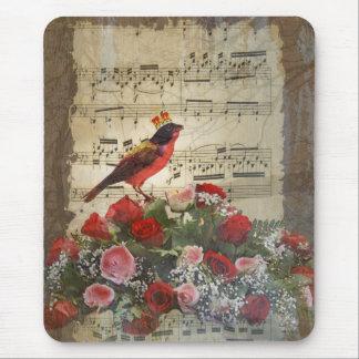 Pájaro rojo, y rosas en la hoja de música del mousepads