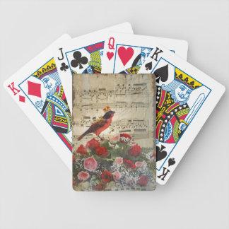 Pájaro rojo, y rosas en la hoja de música del vint baraja cartas de poker