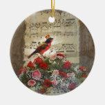 Pájaro rojo, y rosas en la hoja de música del vint adorno