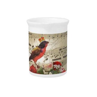 Pájaro rojo y rosas en la hoja de música del vint jarra de beber