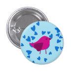 Pájaro rosado con los corazones azules pins