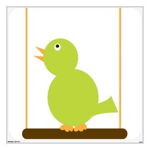 Pájaro verde en una etiqueta de la pared de la per