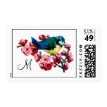 Pájaro y flor de cerezo azules cones monograma