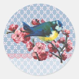 Pájaro y flor de cerezo azules etiqueta