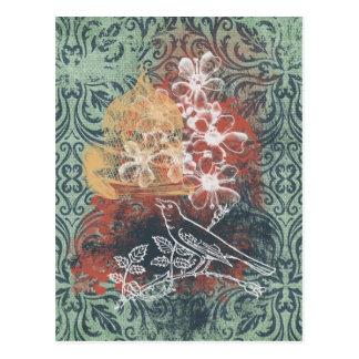 Pájaro y jaula sucios del damasco postal