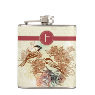 pájaros adaptables en hojas con el frasco de los l