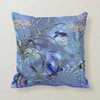 Pájaros azules de las almohadas encantados