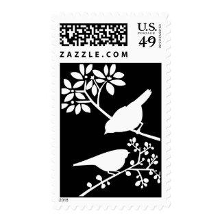 Pájaros blancos y negros franqueo