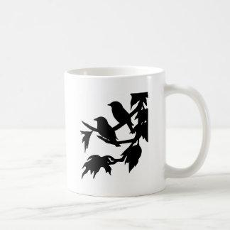 pájaros cantantes taza de café