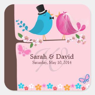 Pájaros de los pares en el pegatina del monograma
