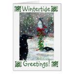 Pájaros del invierno en la tarjeta de felicitación