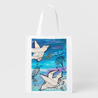 Pájaros en el jardín bolsas de la compra