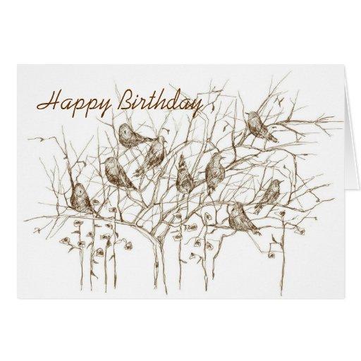 Pájaros en pluma del árbol y tarjeta de cumpleaños