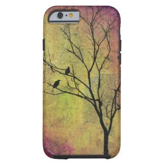 Pájaros en silueta del árbol