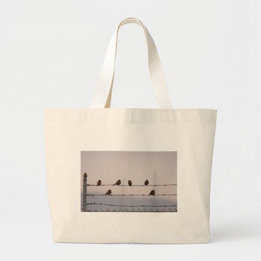 Pájaros en un bolso de la cerca bolsas
