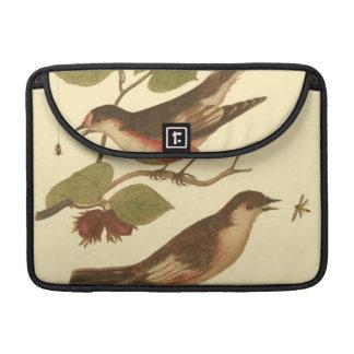 Pájaros encaramados en las ramas que comen funda macbook pro