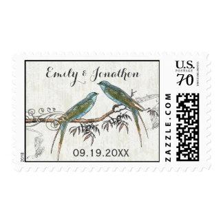 Pájaros esmeralda del amor del vintage que casan franqueo