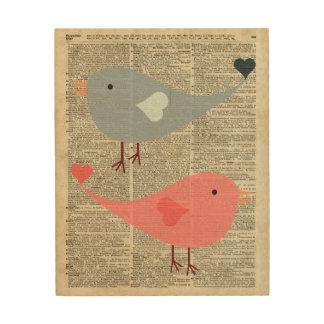 Pájaros preciosos del dibujo animado en la página cuadro de madera