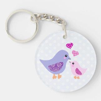 Pájaros rosados y púrpuras lindos de la madre y de llaveros