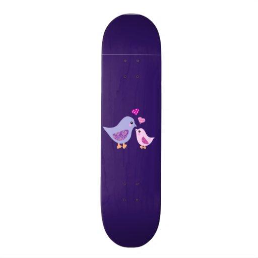 Pájaros rosados y púrpuras lindos de la madre y de patín