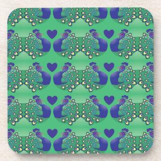 Pájaros verdes y azules hermosos de los pavos real posavasos