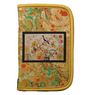 Pájaros y mariposas en folio del papel de mármol planificador