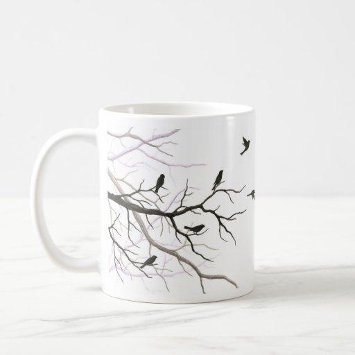 Pájaros y taza de las ramas
