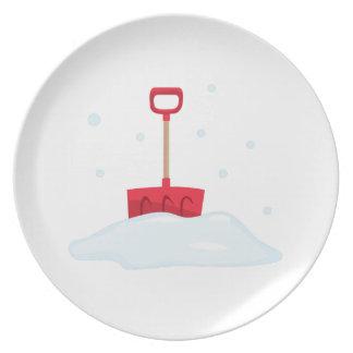 Pala de la nieve plato de cena