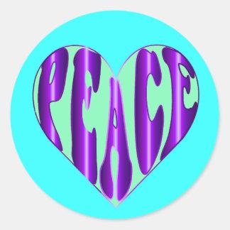 Palabra de la paz en pegatinas del corazón de un pegatina redonda