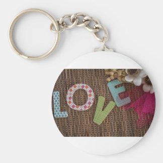Palabra del amor en la rota tejida llaveros personalizados