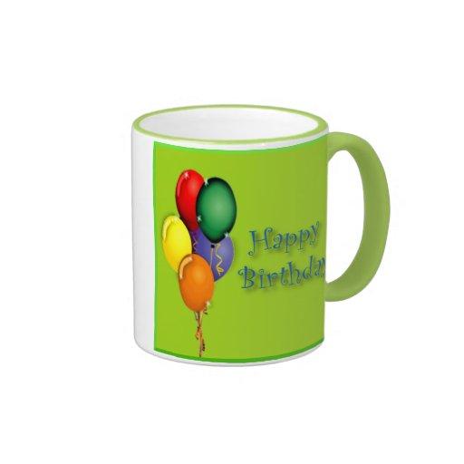 Palabras del feliz cumpleaños con los globos color taza