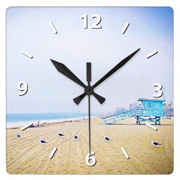 Beach Themed Pale blue sky, golden sandy beach photo wall clock