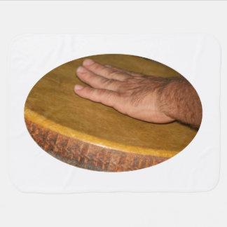 Pale hand on hand drum head skin receiving blanket